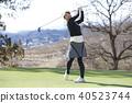 Women playing golf 40523744