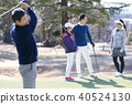 Men and women playing golf 40524130
