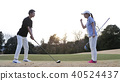 Men and women playing golf 40524437