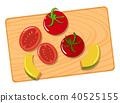 Tomato and pumpkin on cutting board 40525155