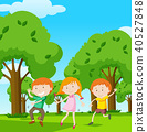 Three kids dancing in the garden 40527848