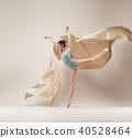 Modern ballet dancer dancing in full body on white studio background. 40528464