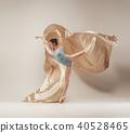 Modern ballet dancer dancing in full body on white studio background. 40528465