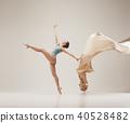 Modern ballet dancer dancing in full body on white studio background. 40528482