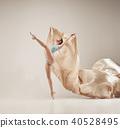 Modern ballet dancer dancing in full body on white studio background. 40528495