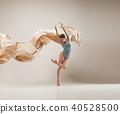 Modern ballet dancer dancing in full body on white studio background. 40528500