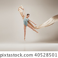 Modern ballet dancer dancing in full body on white studio background. 40528501