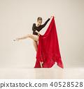 Modern ballet dancer dancing in full body on white studio background. 40528528