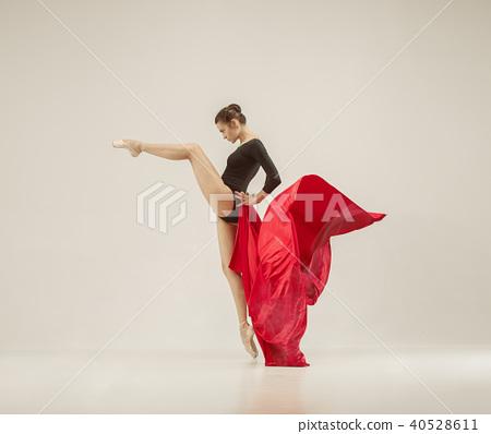 Modern ballet dancer dancing in full body on white studio background. 40528611