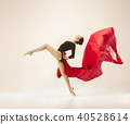 Modern ballet dancer dancing in full body on white studio background. 40528614