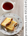 sliced cake with almonds and blueberries 40538345