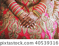 Indian bride with menhdi (henna) and bangles 40539316