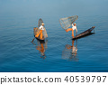 Burmese fishermans on boat catching fish. Myanmar 40539797
