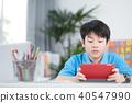 Asian cute boy using tablet computer. 40547990