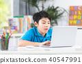 Asian cute boy using laptop computer. 40547991