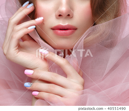 Beautiful girl with light make-up and gentle manicure in pink clothes. Beauty face. Design nails. 40551490