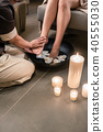 Hands of an Asian therapist during foot washing treatment 40555030