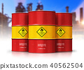 Group of red oil drums in front of refinery plant 40562504