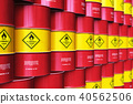 Group of rows of red stacked oil drums in storage 40562506