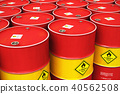 Group of rows of red stacked oil drums in storage 40562508