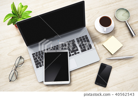 Laptop, tablet and smartphone on office table 40562543