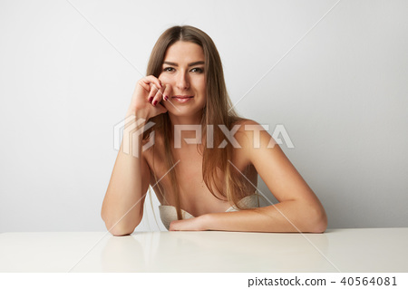 Young beautiful woman posing at the camera impressively on a light Background. Girl portrait. Beauty 40564081