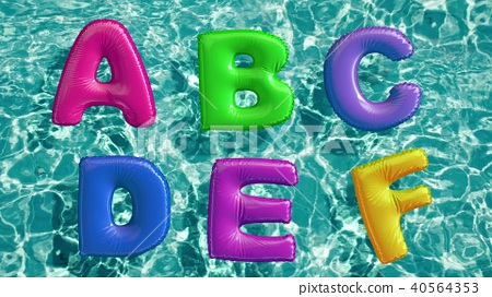 alphabet made of shaped inflatable swim ring floating in a refreshing blue swimming pool 40564353