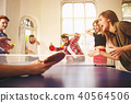Group of happy young friends playing ping pong table tennis 40564506