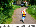 Little girl on her way to her first day of school 40564704