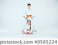 The group of boys and girl at Aikido training in martial arts school. Healthy lifestyle and sports 40565224