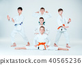 The group of boys and girl fighting at Aikido training in martial arts school. Healthy lifestyle and 40565236