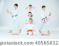 The group of boys and girl fighting at Aikido training in martial arts school. Healthy lifestyle and 40565632