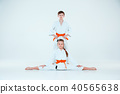 The boy and girl posing at Aikido training in martial arts school. Healthy lifestyle and sports 40565638