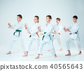 The group of boys and girl fighting at Aikido training in martial arts school. Healthy lifestyle and 40565643