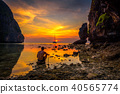 Young boy enjoys dramatic sunset at Maya beach in Thailand 40565774