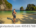Young boy films the beach on the Koh Hong island in Thailand 40565788
