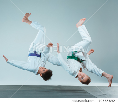 The two boys fighting at Aikido training in martial arts school. Healthy lifestyle and sports 40565892