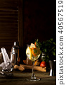 Cocktail with rosemary, lemon and orange on dark wooden backgorund 40567519