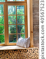 Bright room interior with curtains, wooden window sill and pillows 40567523