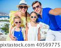 Family having fun outdoors on Mykonos island 40569775