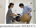 laundry, heterosexual couple, washer 40582471