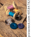 spool of threads and buttons 40584782
