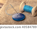 button with needle and thread 40584789