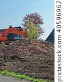 Heap of old bricks and hydraulic excavator arm 40596962