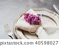 Spring table place setting with violet lilac. 40598027