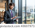 Men with tablets 40607973