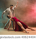 Flexible young modern dance couple posing in studio. 40624404