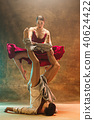 Flexible young modern dance couple posing in studio. 40624422