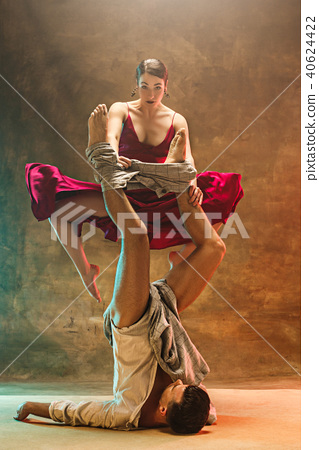 Flexible young modern dance couple posing in studio. 40624422