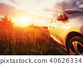 road car on a field at sunset. Ukraine Europe 40626334